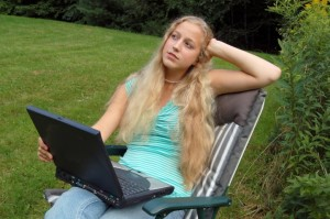 Female student outdoors with computer